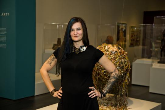 Amanda M. Maples in the Thomas K. Seligman Gallery of African Art, Cantor Arts Center, where she installed the permanent exhibition In Dialogue: African Arts. Photo courtesy of Cantor Arts Center, Stanford University.