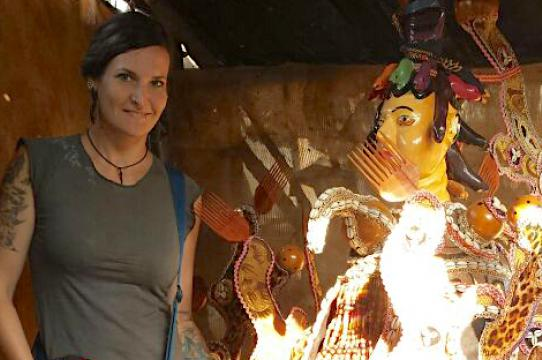 Amanda M. Maples with an Ordehlay mask in Lunsar, Sierra Leone.